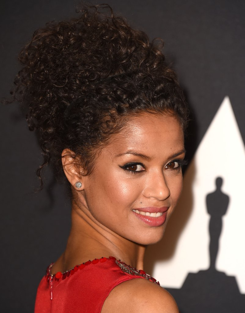 Gugu Mbatha Raw curly hairstyles messy up-do