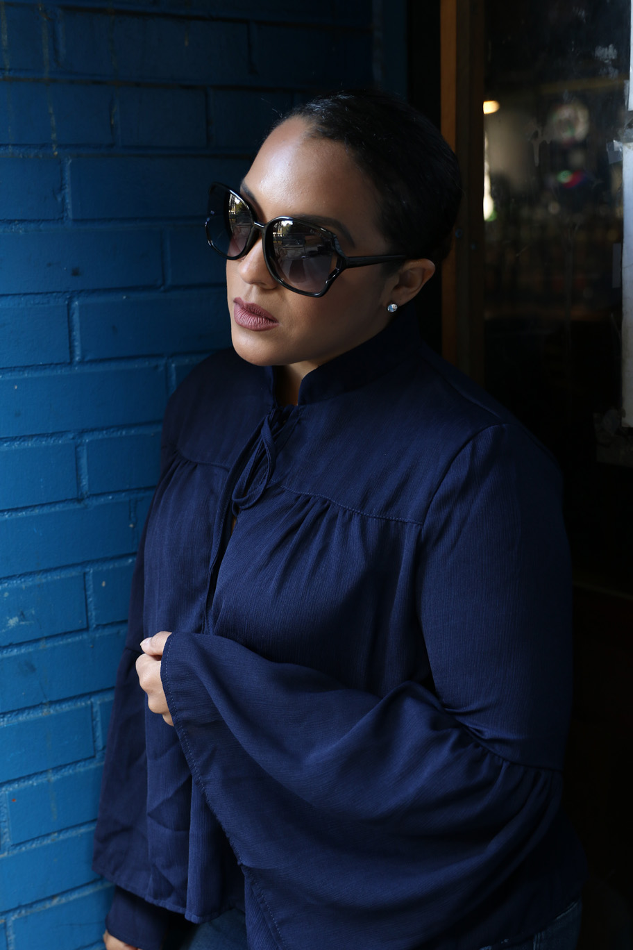 Bebe black sunglasses and bell sleeves outfit - NYC style blogger Miriam Morales