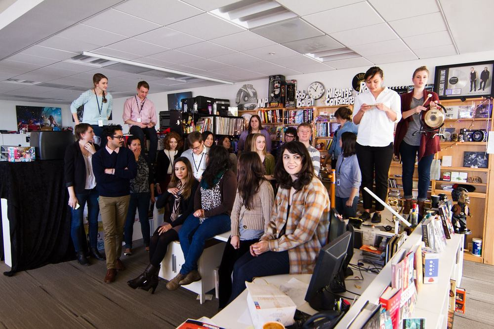Caroline's NPR intern class. Caroline, at right, is standing on the one and only Tiny Desk.