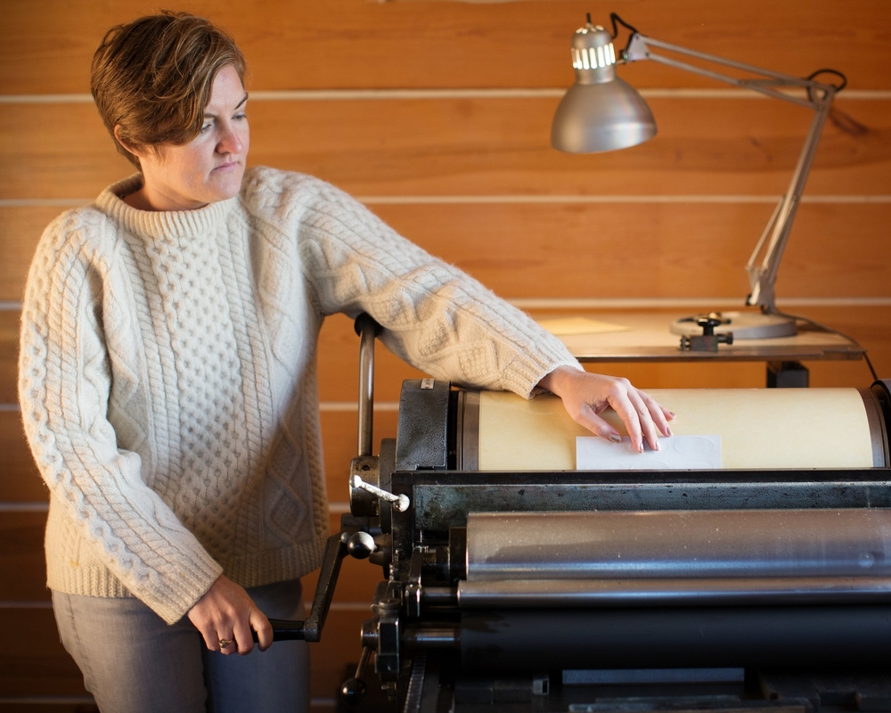 Emily Johnson using a letterpress