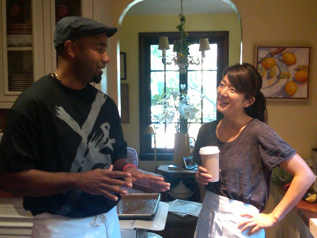 CHEF MARCUS AND CHEF LISA EXCHANGING TIPS ON CLARIFIED BUTTER