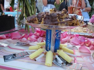 Check out the creative presentation - hair curlers, bud light can, and cigarettes!