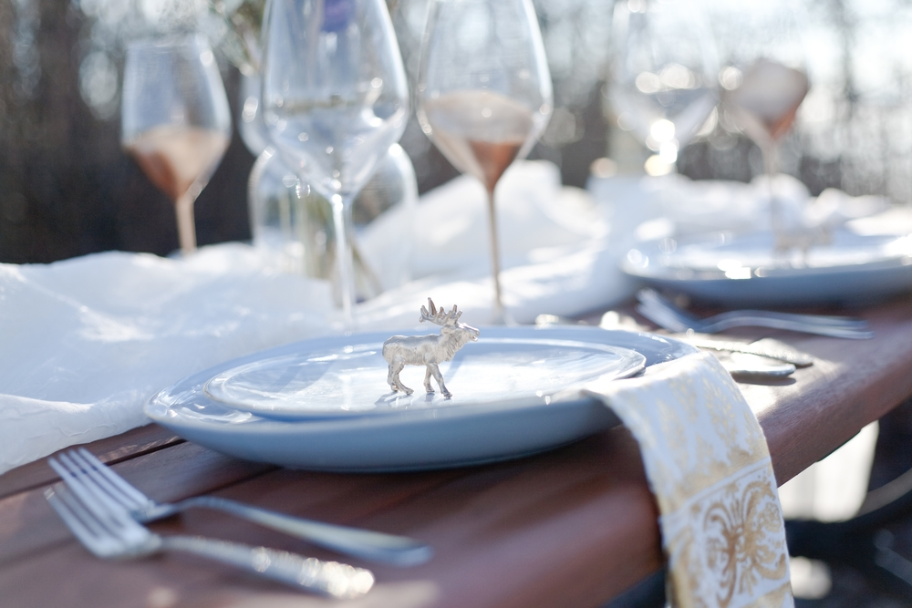 This image is from our very first styled shoot with Photographer Kaylee Stevie. We spray painted little woodland creatures for each place setting.
