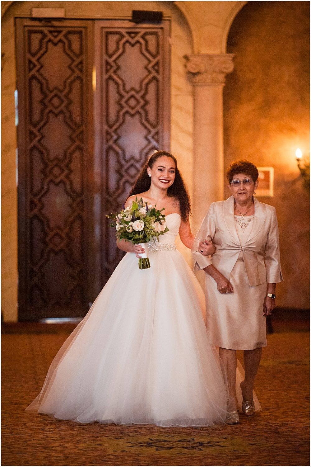 bride coming down the aisle with her mother at the biltmore hotel