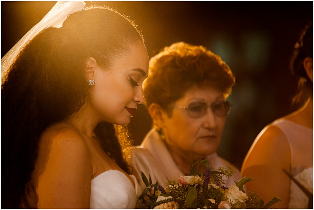 intimate photograph of bride coming down the aisle with her mother