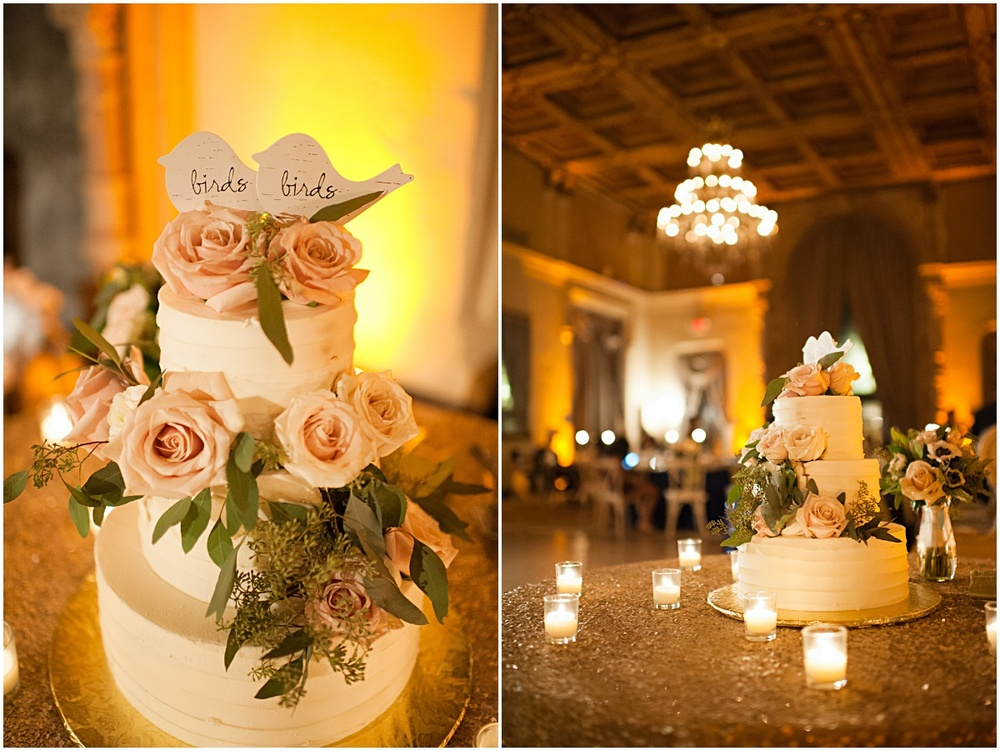 White rose buttercream wedding cake with wooden bird toppers