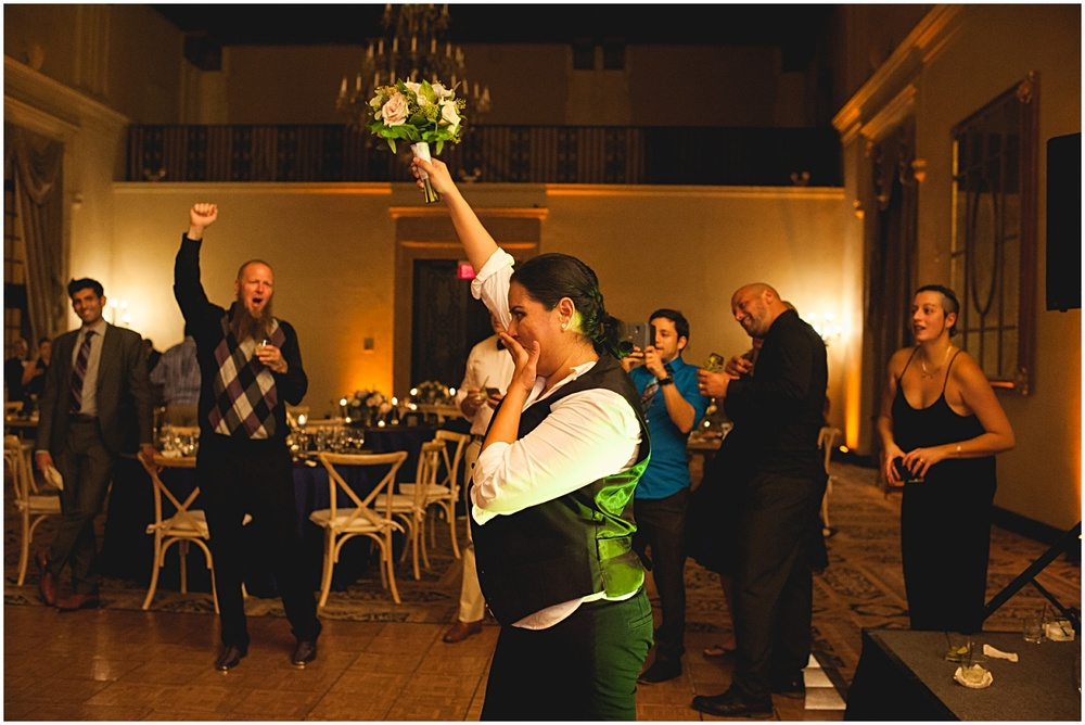 bride throwing white rose bouquet at the biltmore hotel