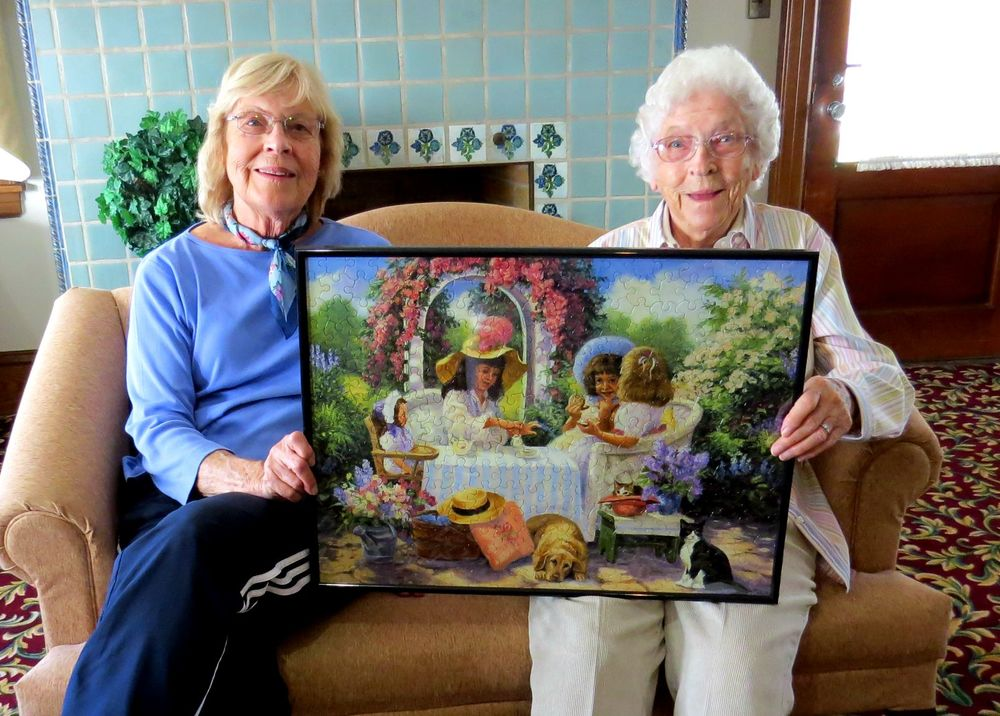 Yvonne_Wright_and_daughter_holding_framed_puzzle.jpg