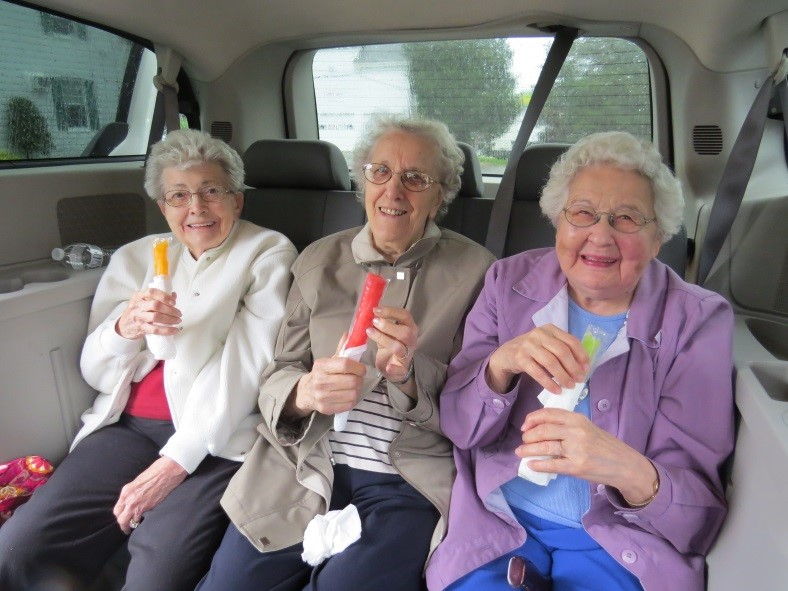 Ladies_enjoying_ice_pops.jpg