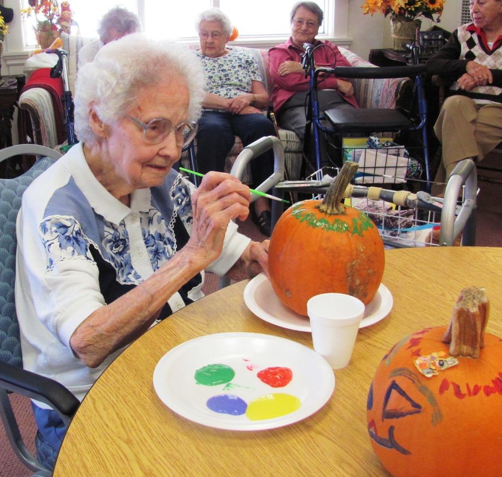 Louise_Garnier_painting_pumpkin.jpg