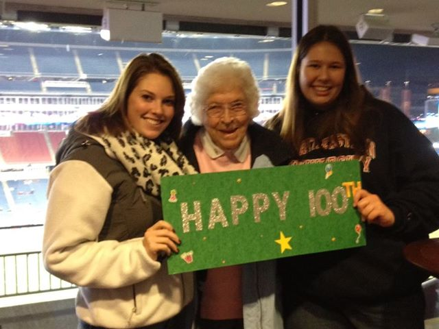 Yvonne_at_New_England_Revolution_Game_2013_with_100th_sign.jpg