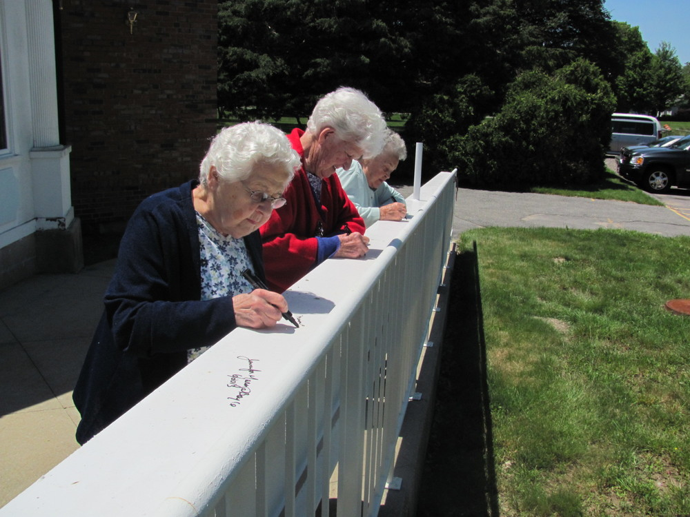 Topping_Off_Ceremony_June_2013_-_Residents_signing_the_beam.jpg