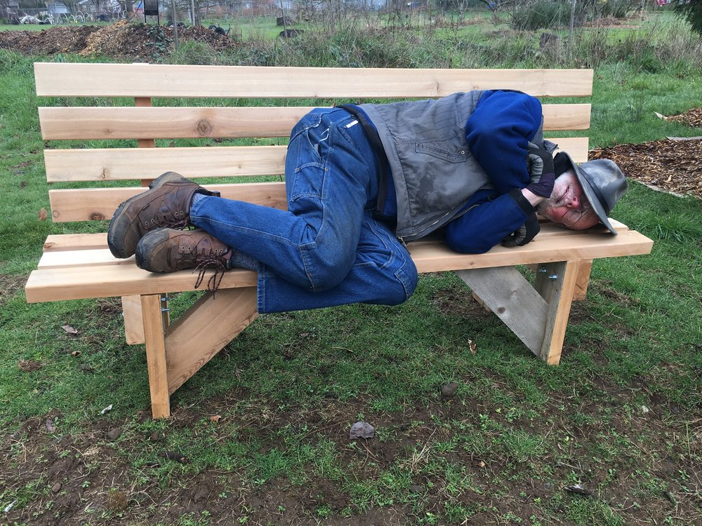 Weary gardener rests on new annex bench.    Photo: John Jordan