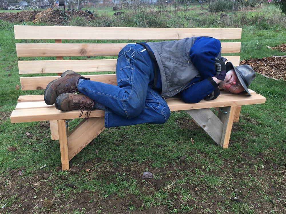 Weary gardener rests on new annex bench.  Photo: John Jordan