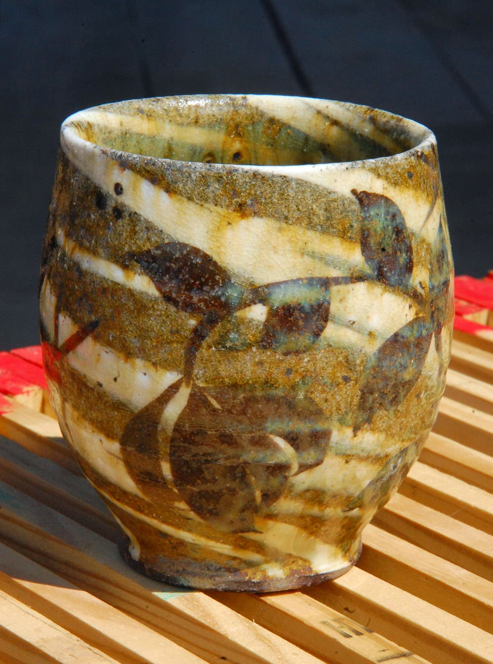 yunomi for AKAR Design Gallery with wax resist swirlware floral motifs porcelain local native clay pottery