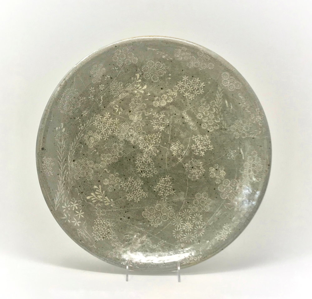 Serving Platter  (2018)   17' diameter, stoneware, incised, stamped, inlaid   with porcelain.