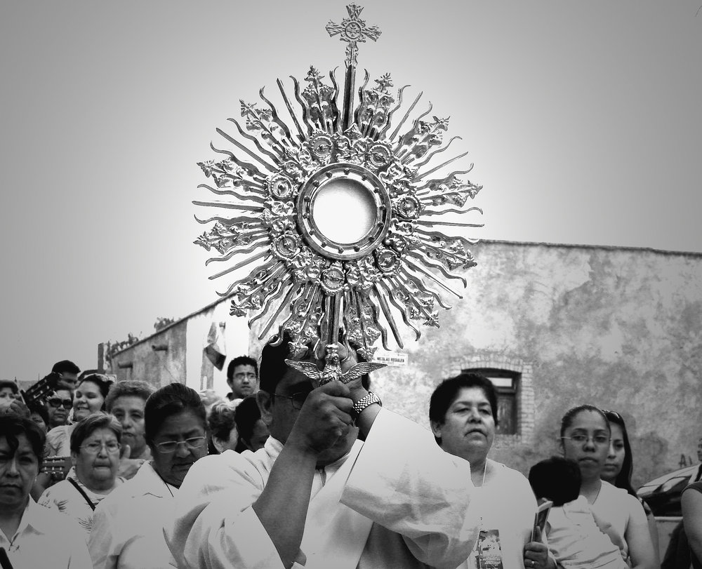 This photo was taken back in 2009 when I was living in Saltillo, Mexico as a missionary. I decided to document the Eucharistic procession on this amazing feast of Corpus Christi. It was an awesome experience to walk through the neighborhood around the parish we were serving that year with literally hundreds of parishioners, bringing Jesus to the streets!