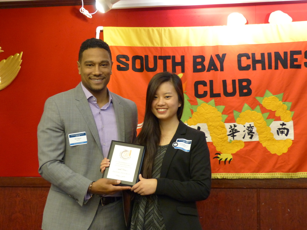 Ken Maxey of Comcast presented the award certificate and the $1,000 scholarship award to Enya Entung Kuo of Irvington High School at the 2015 SBCSC Scholarship Award Banquet.