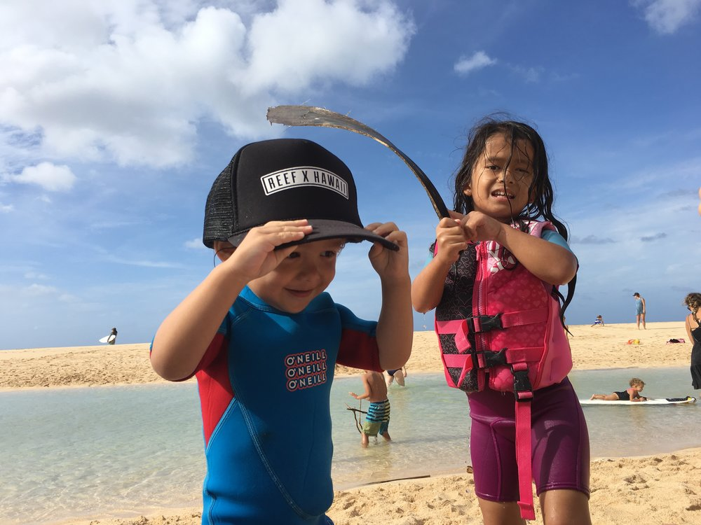 Ethan Ryker and Mila James enjoying the sandbars of winter in Hawaii.