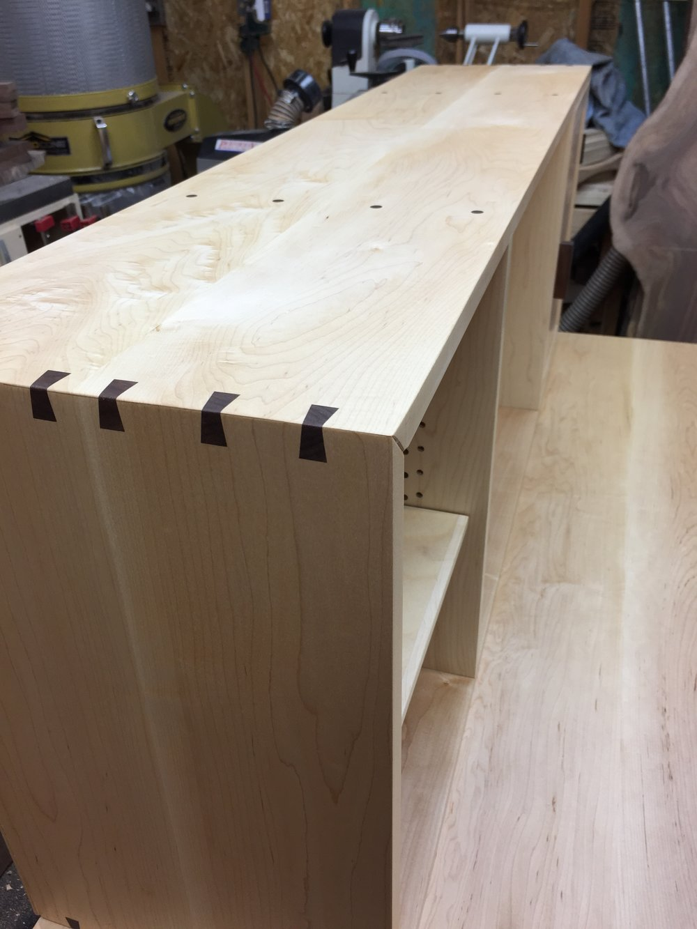 Walnut sliding dovetail splines, used to reinforce the miter joints.