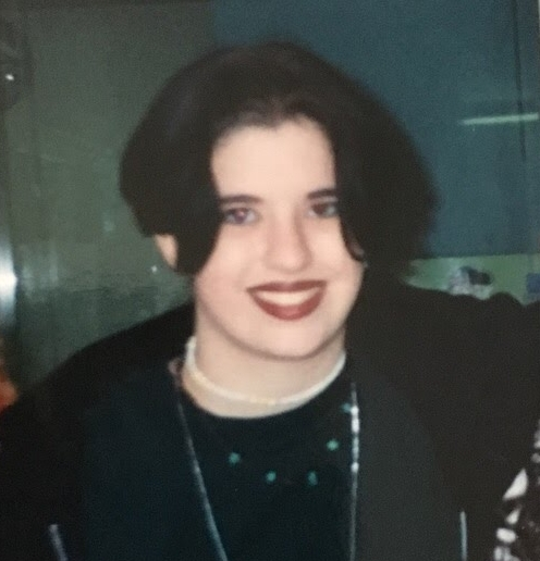 A much younger, girly tomboy me, very likely with a hole or two in that hoodie!