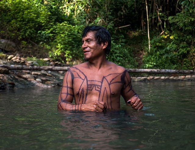 "Walter, from the native community of Shintuya, told us many stories from the times his grandfather was the chief of this community and welcomed the white or ""colonos"" for the first time. As we spent an evening dip in the natural hot springs, his passion for his ancestry and his own culture was evident through his stories. 📷: @lina_collado"