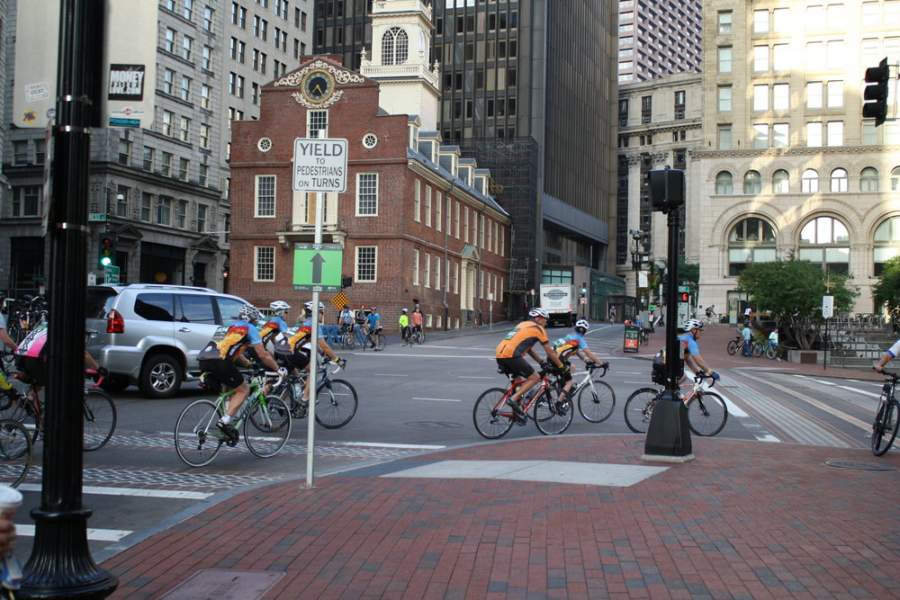 Berkshires to Boston Riders pass the Old State House in Boston