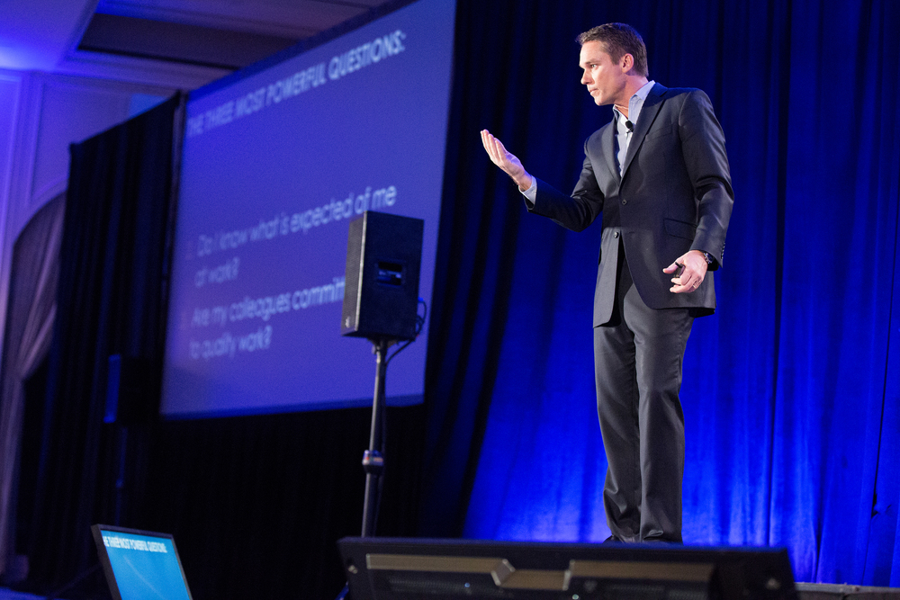 Image of author Marcus Buckingham giving a speech at a corporate event. Photo by Booker T Brown photography