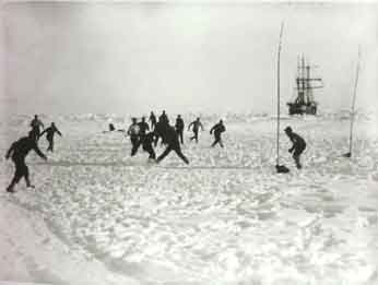 The men playing football on the ice.