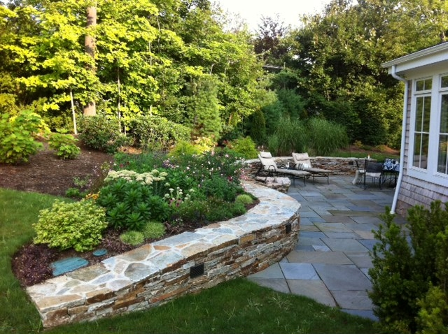 Bluestone patio and stone retaining wall.JPG