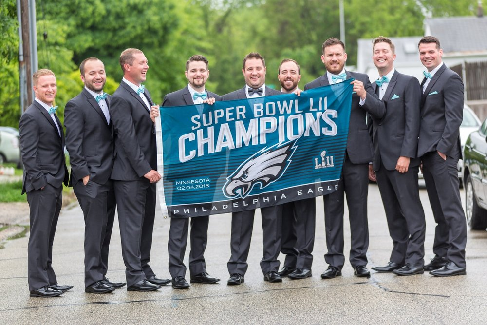 groomsmen-hold-eagles-flag-at-wedding