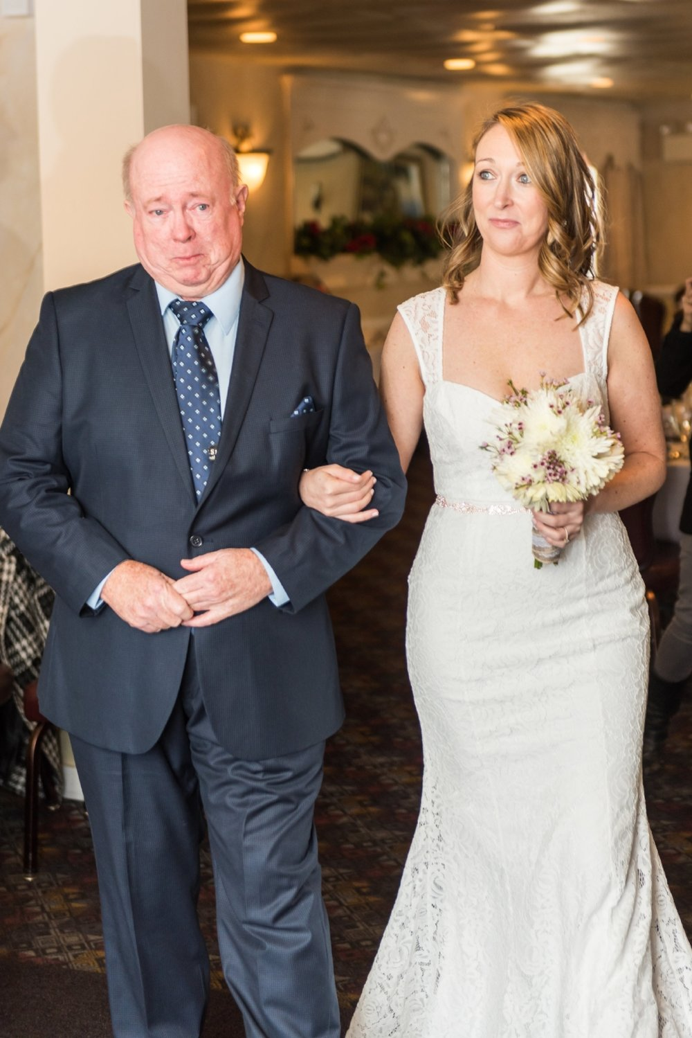 father-and-bride-walking-down-aisle