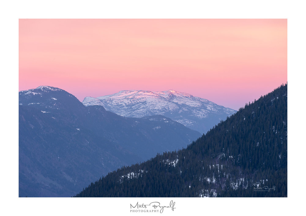 View over Dalen, Norway mountain range at sunset.