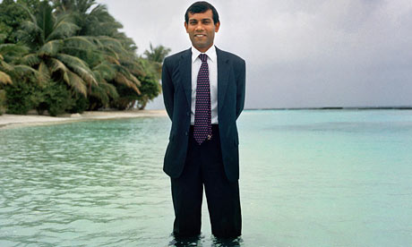 The Maldives president Mohamed Nasheed stands in the sea off Kurumba to show the threat the islands face. Photograph: Chiara Goia. Source: Guardian.