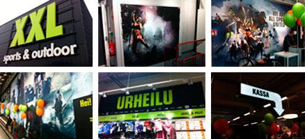 XXL:n myymälämainosmateriaalit sisä- ja ulkotiloihinSuomessa  Mm. akryyliset, kangaspinnotteiset LED-kyltit, isot kuvakalvot seiniin ja oviin, tuoteryhmäbannerit, magneetti-infoseinät, valaisevat opastenuolet.