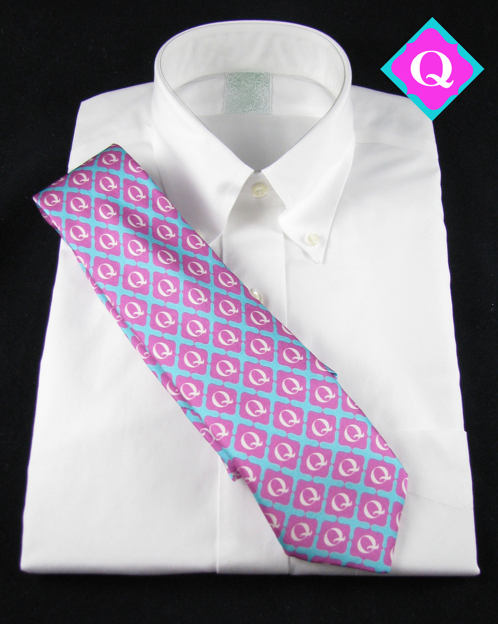 This Q logo was set into repeat, then printed.  Silk Necktie
