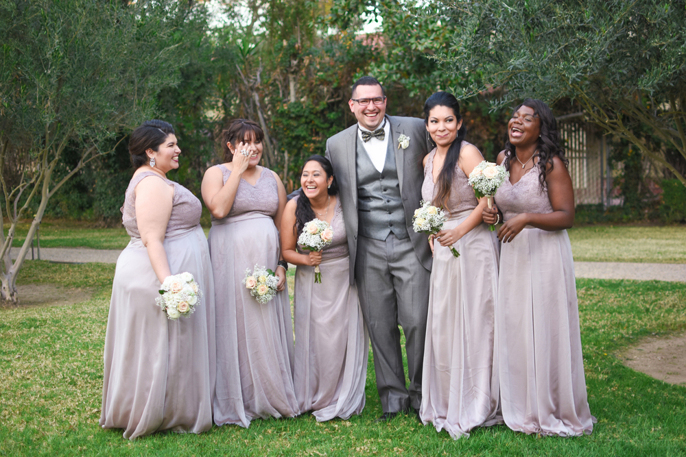 Laughing Lavender Bridal Party With Groom