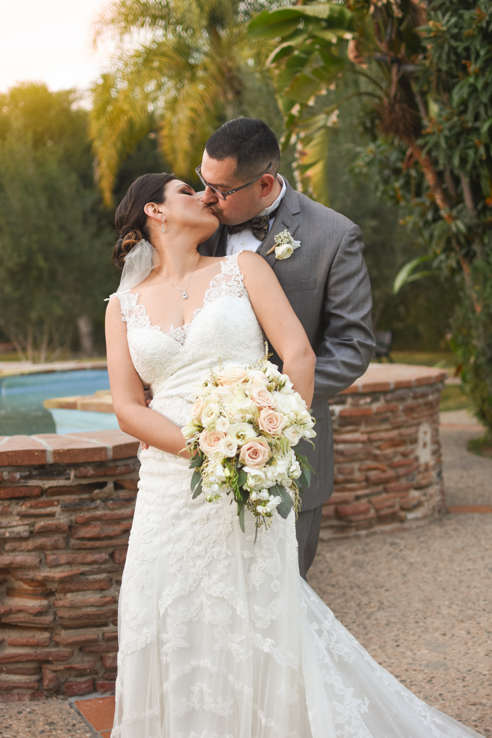 Bride and Groom Kiss - White Bouquet