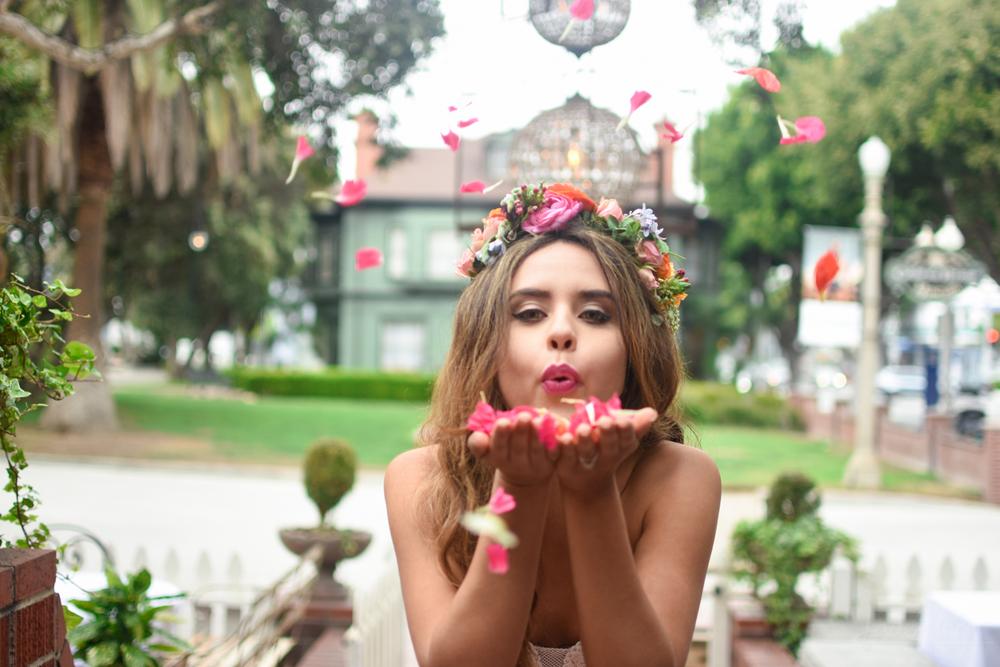 Victorian Santa Monica Bride Blowing Confetti Rose Petals