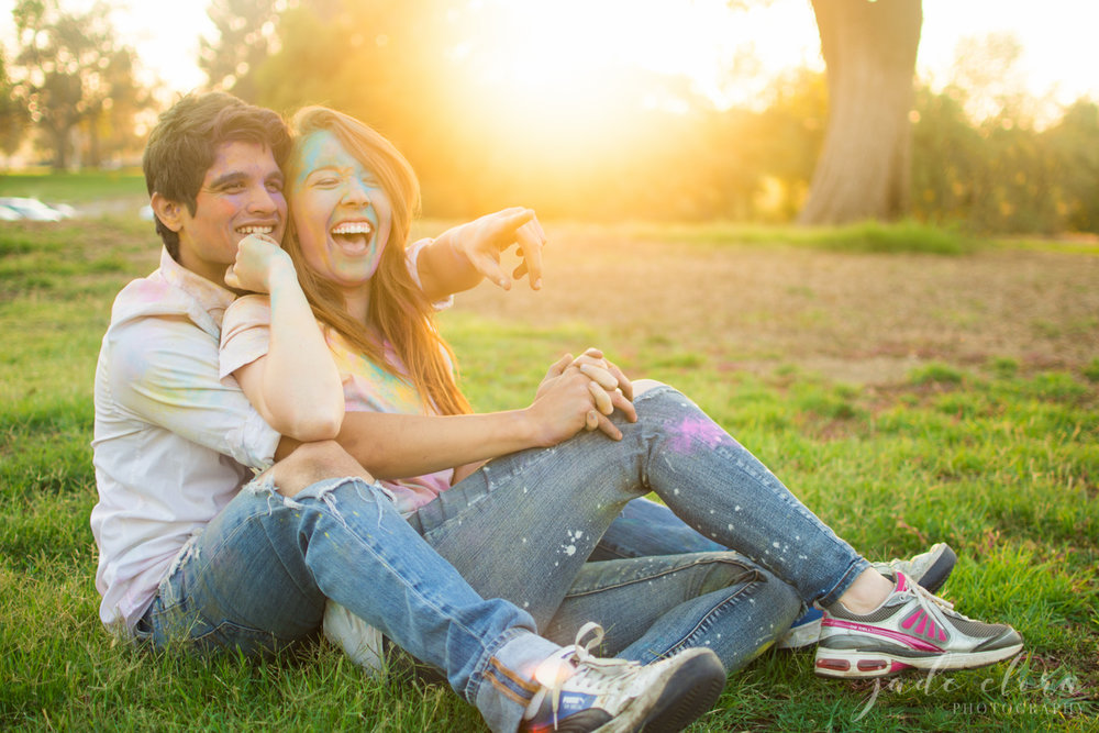 Couple Playing at the Park Covered in Colored Powder