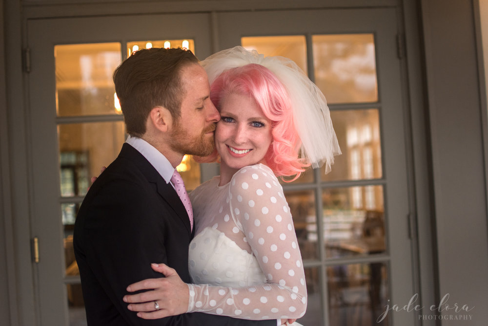 Groom Kisses Pink-Haired Bride on Her Cheek