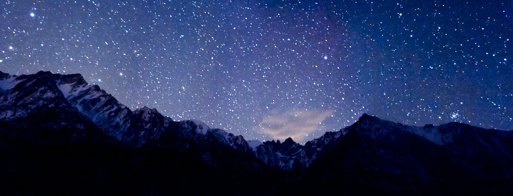 A astro panoramic landscape image of Mt Whitney at the Sierra Nevadas.