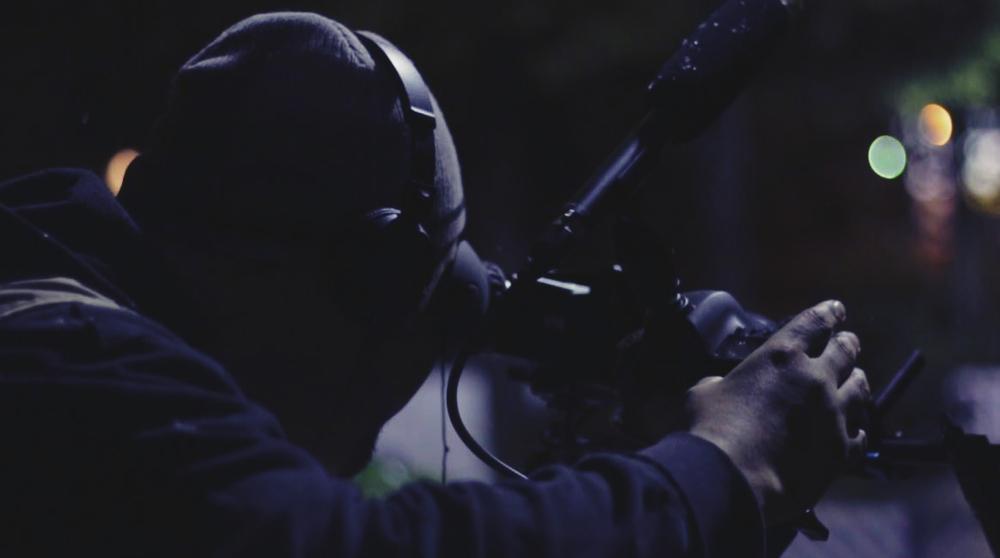 Cinematographer Rolando Herrera behind the camera.