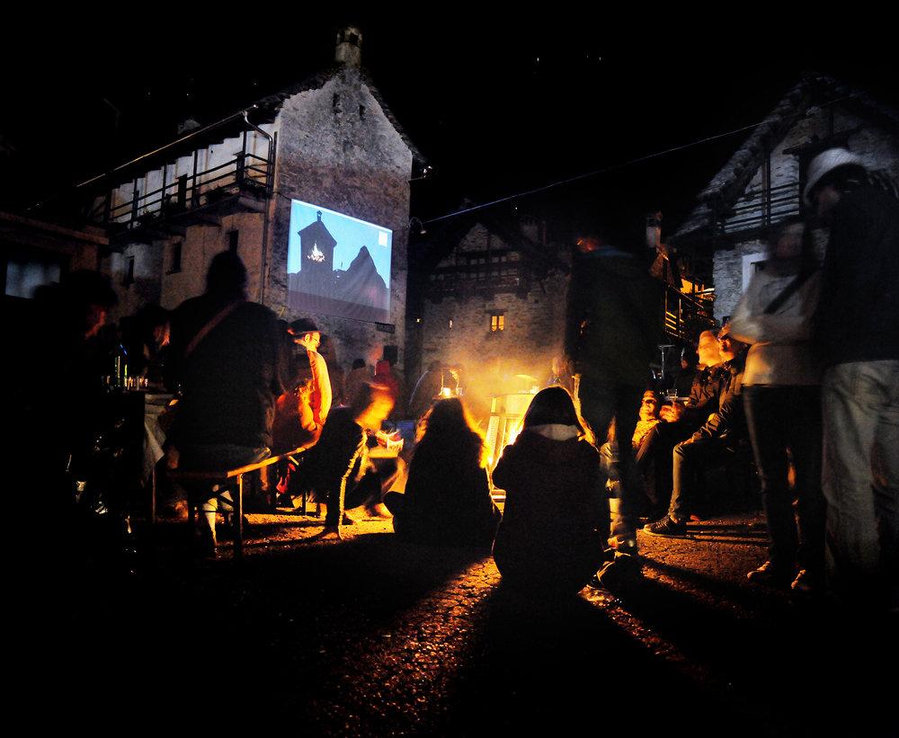 NOTTE DELLA FOTOGRAFIAOUTDOOR PROJECTIONSGENUINE FOOD & DRINKSLIVE MUSICGROTTO MEETINGSROUND TABLESARTIST PRESENTATIONSGOOD VIBES -