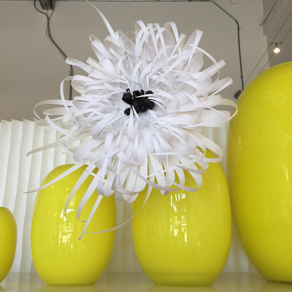 Black and white paper spider mum on display in a Piet Hein Super Ellipse Vase at The Passdoor