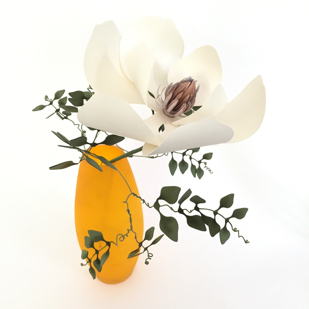 Paper southern magnolia with creeping paper jasmine vine.