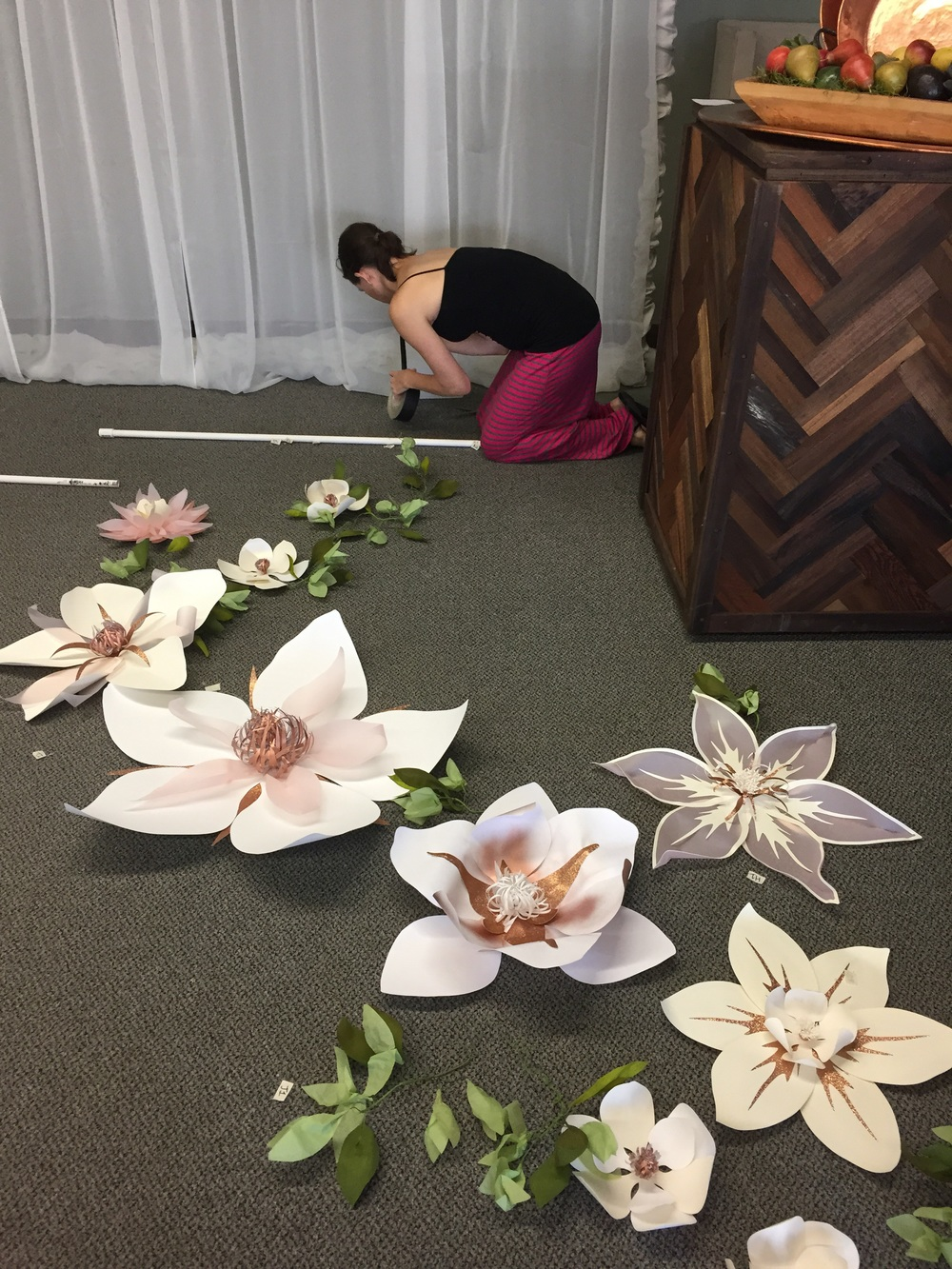 The amazing Carolyn Wilson being an amazing assistant down on her hands and knees helping me mount the flower backdrop.
