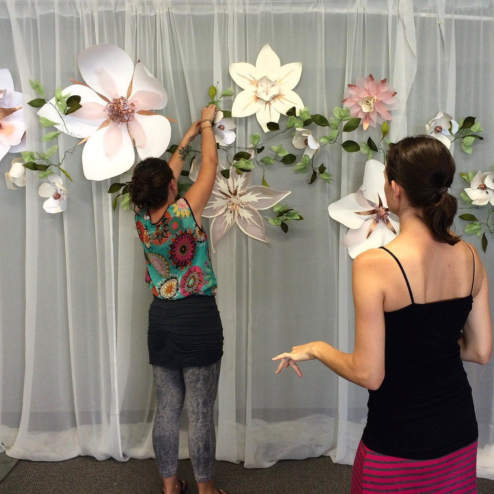 Putting the finishing touches on the backdrop before it is raised up to 10 feet high.