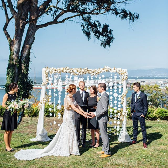 Paper_flower_ceremony_backdrop__What_a_gorgeous_setting_for__thebigfakewedding_at_The_General_s_Residence_Fort_Mason_on_a_perfect_day._Thank_you__weddingsbysunnyside_for_taking_such_amazing_photos_and_helping_out_so_much_that_day._Love_you_guys____pa.jpg