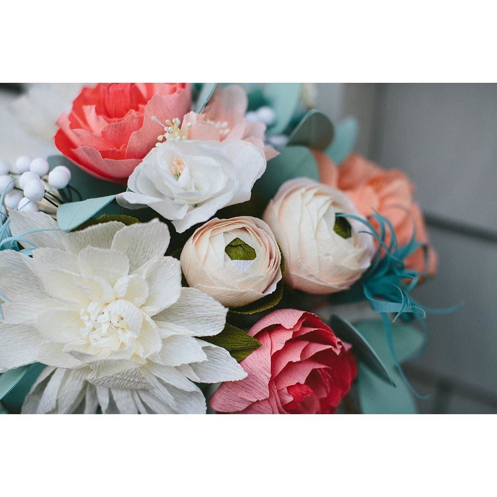 Up_close_and_personal_with_the_ranunculus_and_other__paperflowers_in_this__bridalbouquet__Photo_by__dianarothery.jpg